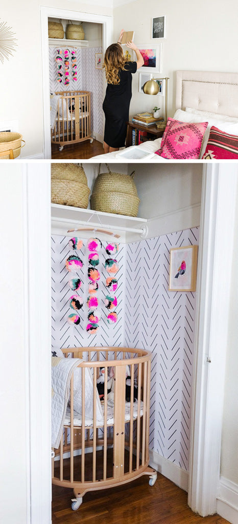 Walk-in closet turned into nursery with removable wallpaper and pink decors