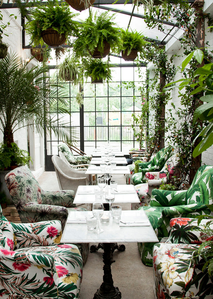Greenhouse inspired restaurant interior in London