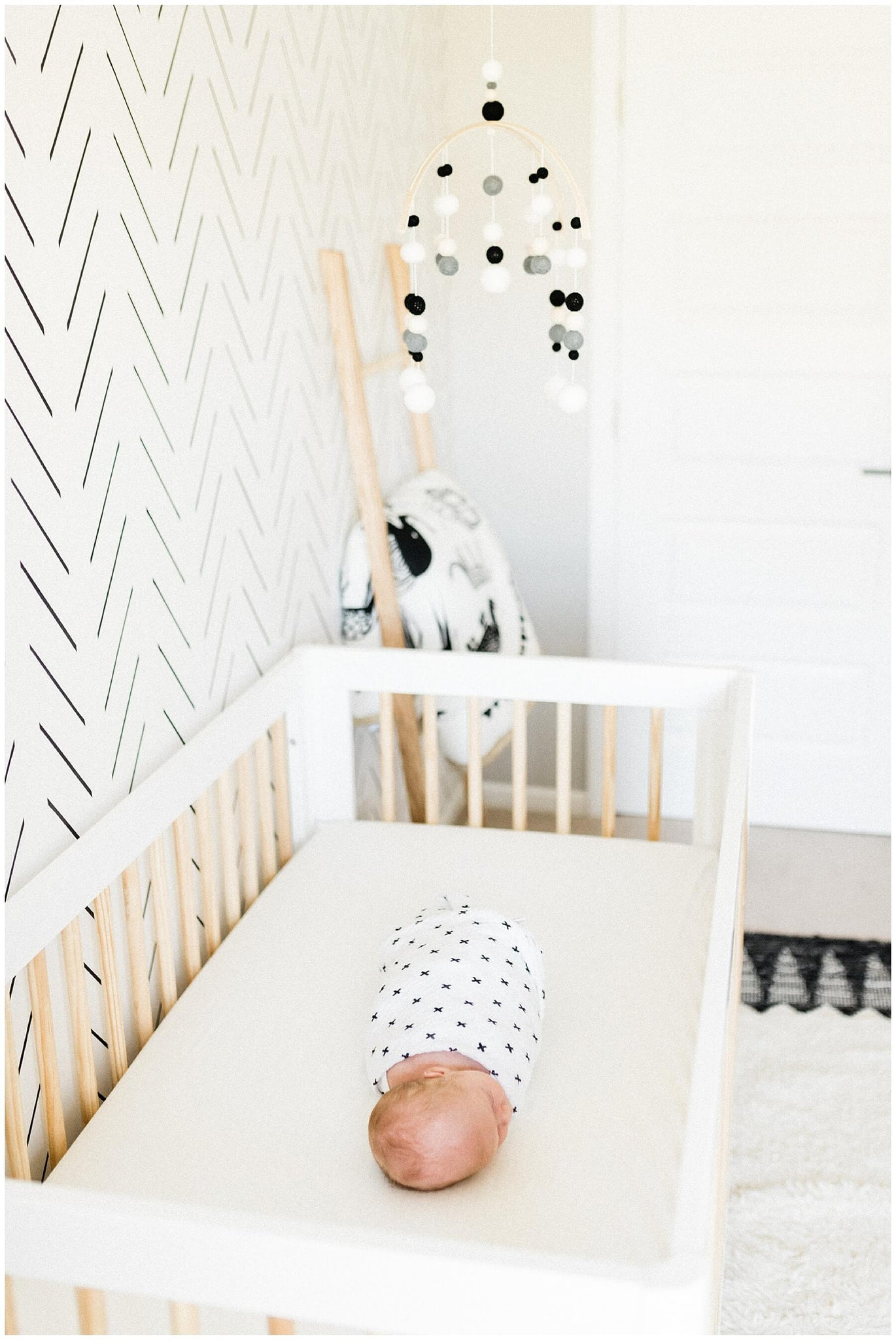 Newborn photography in moder minimal scandinavian nursery interior
