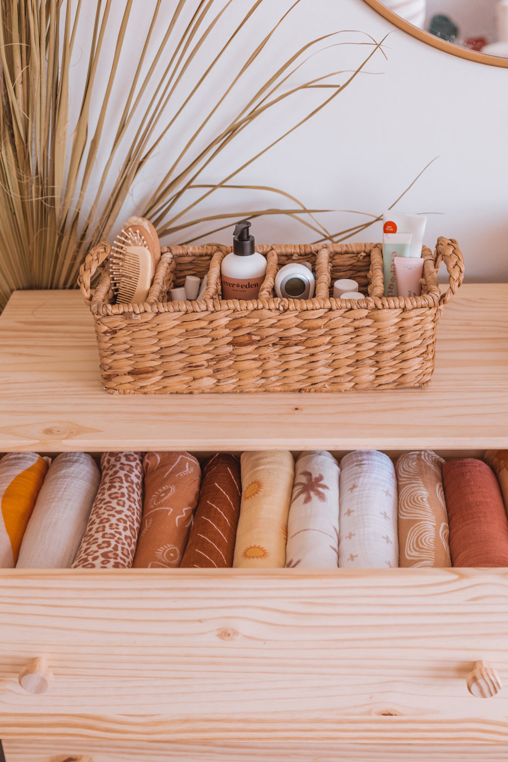 Baby nursery changing table essentials in seagrass woven basket