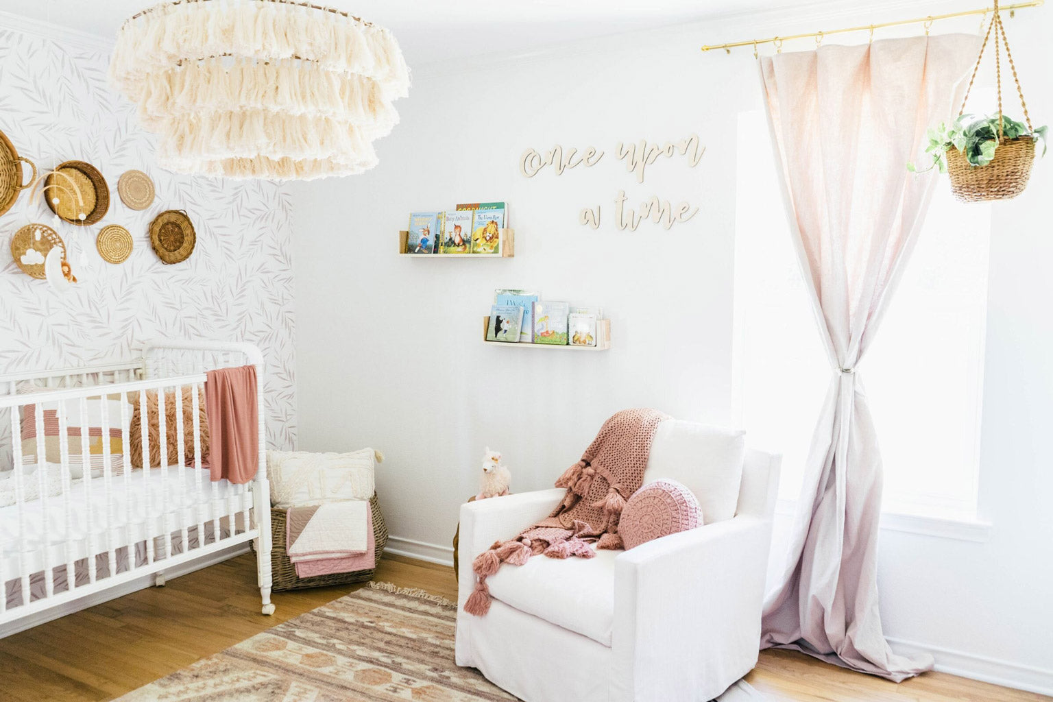 Dreamy baby girl nursery with botanical foliage removable wallpaper