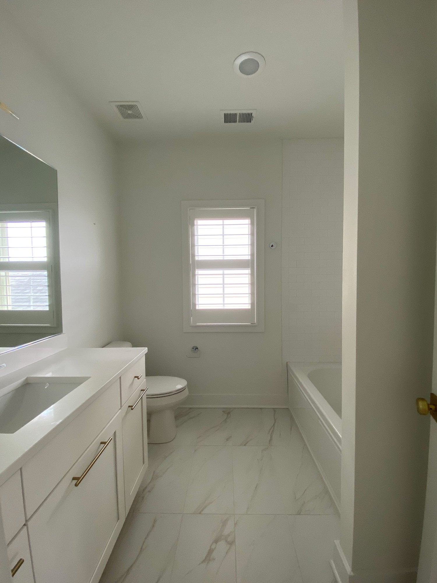 Before and after guest bathroom remodel featuring removable wallpaper designs