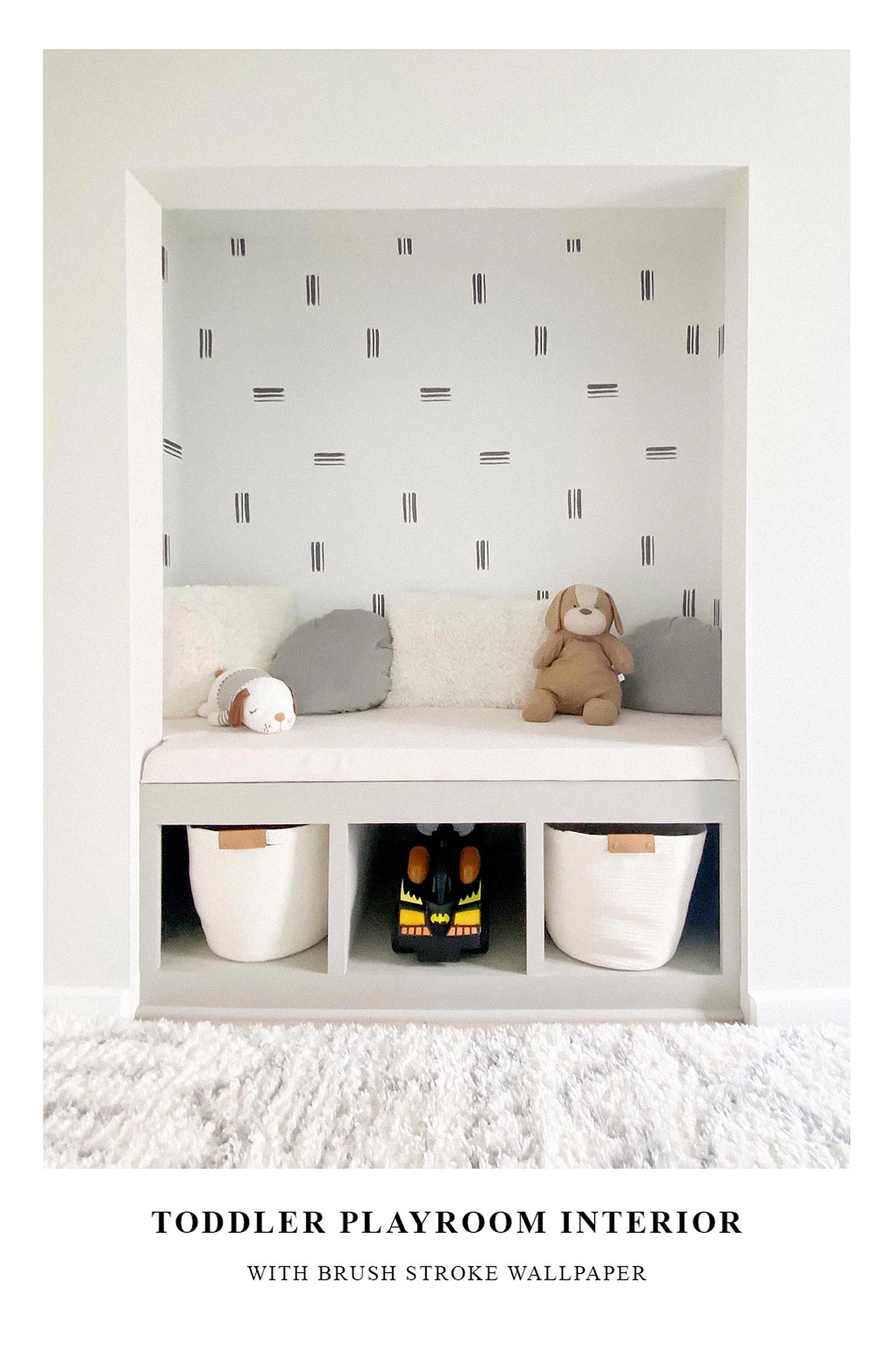 Toddler playroom interior inspiration with minimal brush stroke removable wallpaper in closet reading nook