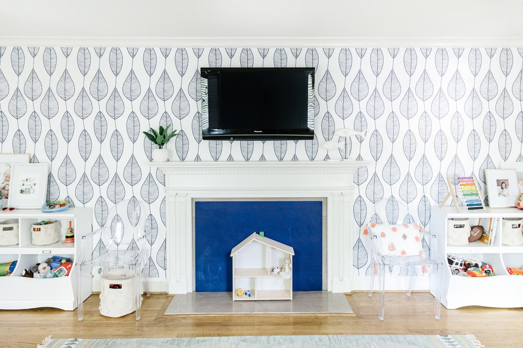 Blue leaves removable wallpaper in a white playroom interior