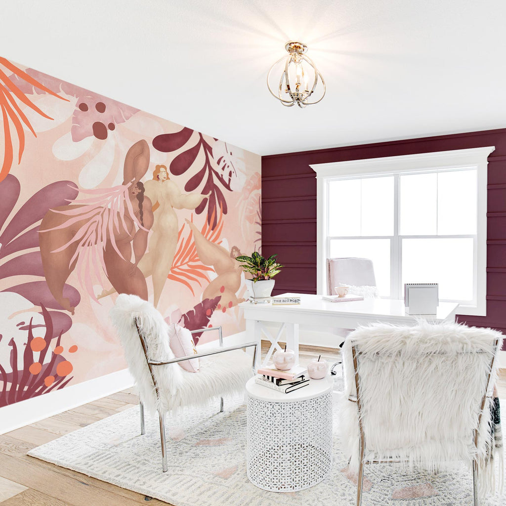 Boho chic home office interior with pink color palette and feminine wall mural