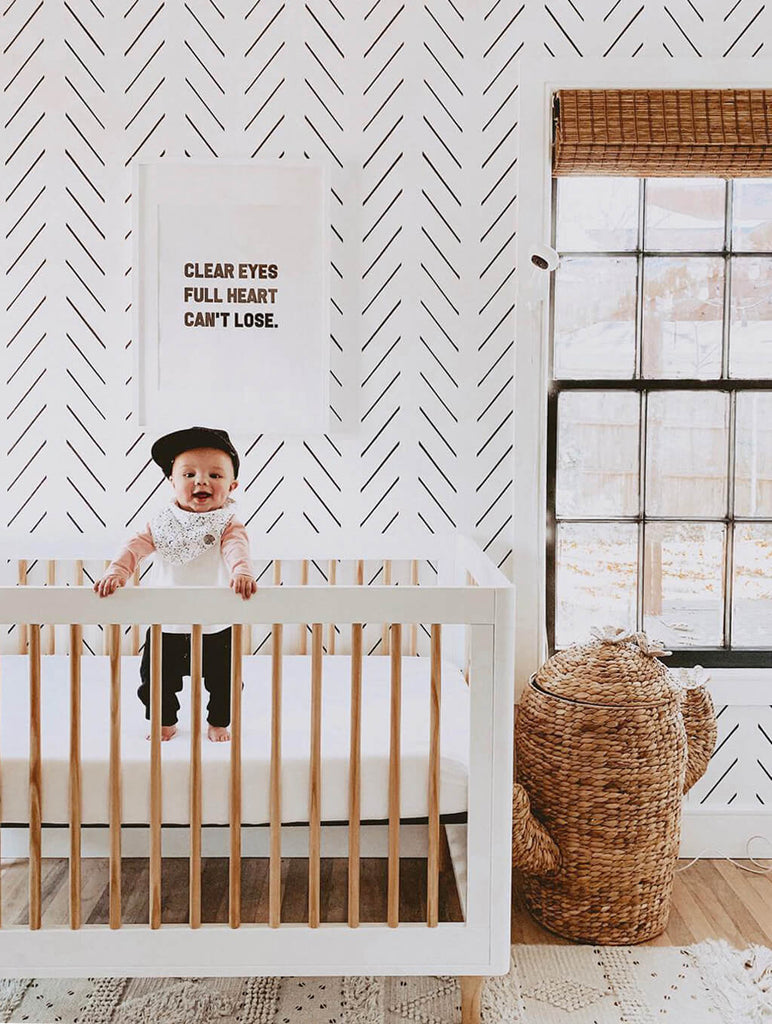 Boho boys nursery with herringbone removable wallpaper