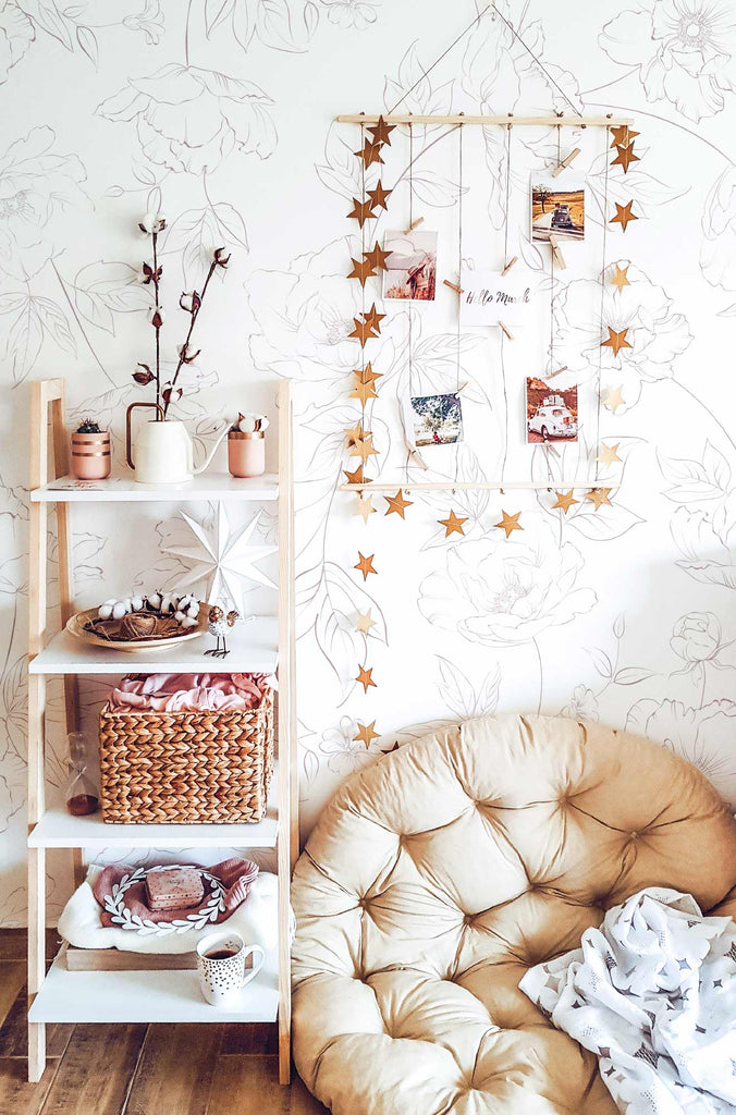 Boho style girls nursery with floral pink wallpaper and interior decor