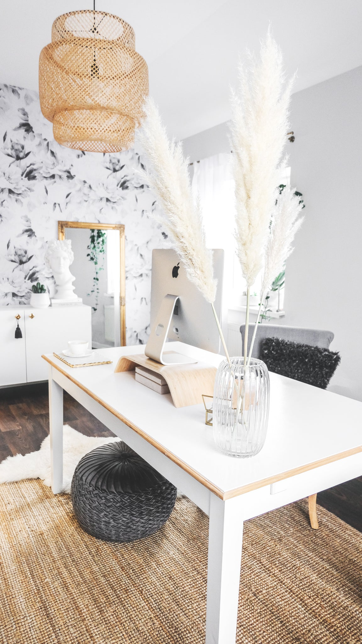 Pampas grass floral arrangement on a white desk in bohemian office