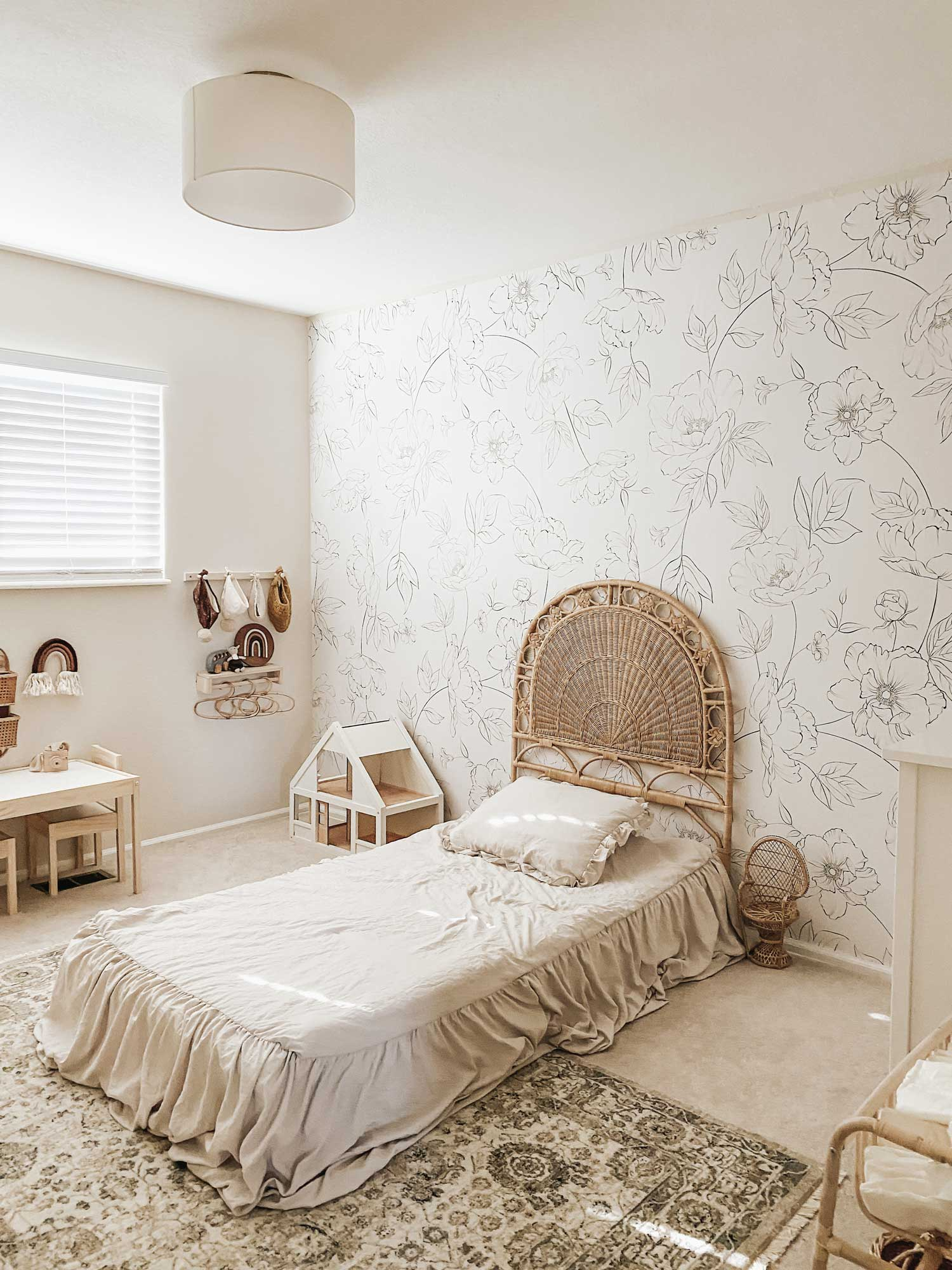 Beach bohemian style girls room with rattan furniture and rainbow themed toys