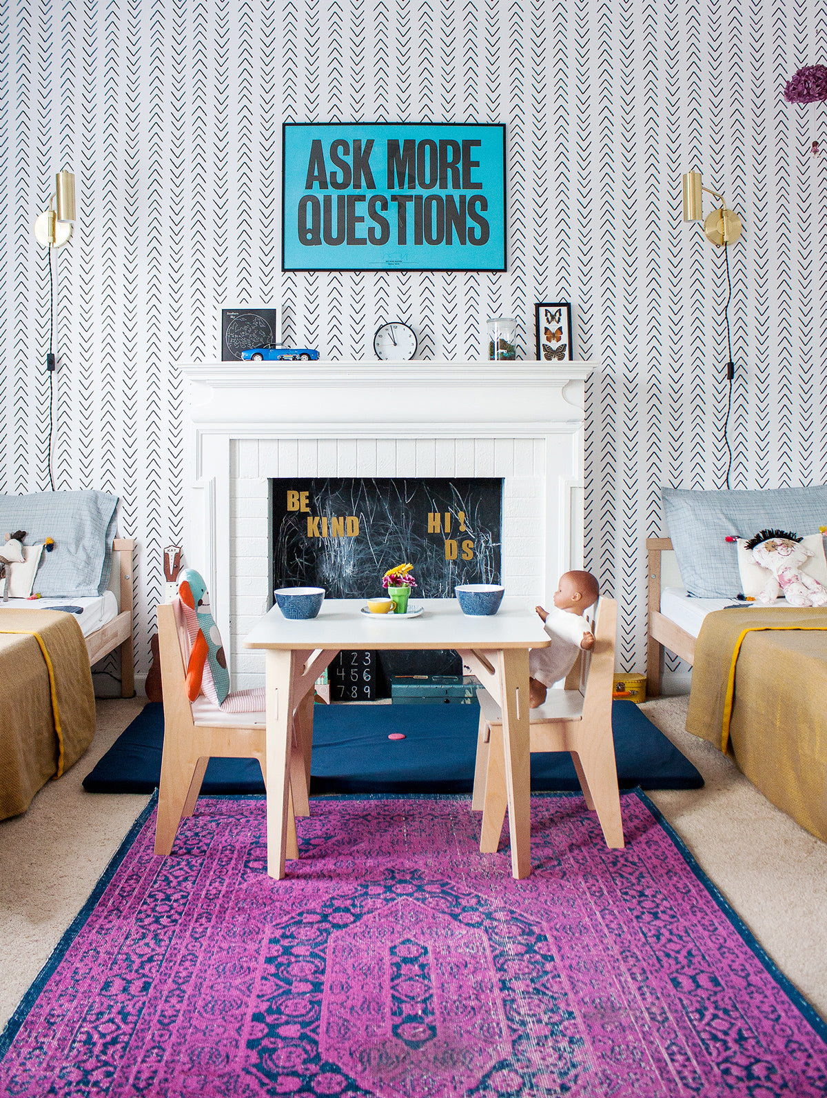 Bright shared kid's bedroom with Scandinavian wallpaper and coloful decor elements