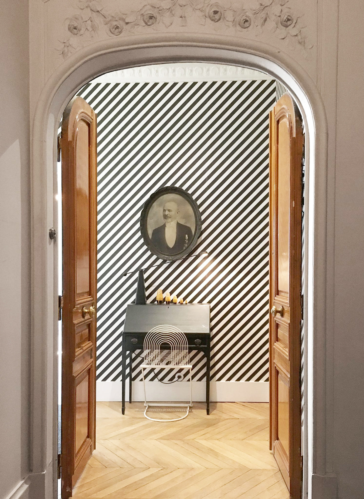 Eclectic Parisian apartment with geometric removable wallpaper and white crown molding