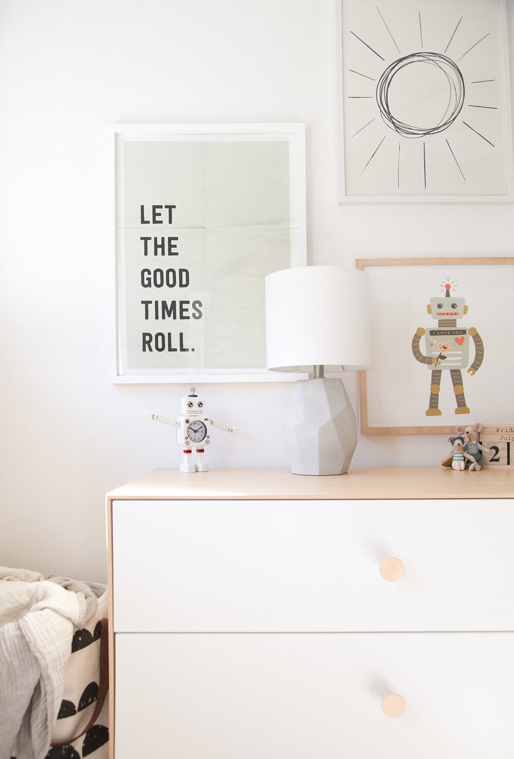 Boys room gallery wall with robots and minimal style art