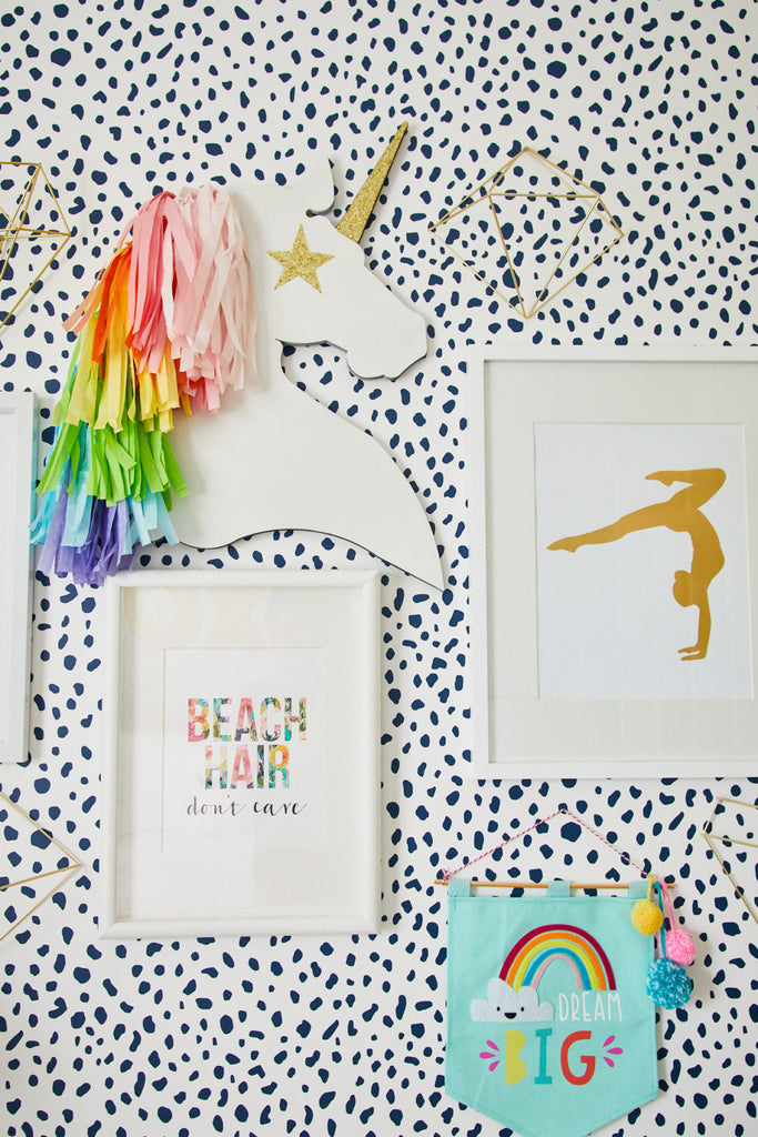 Bright girls room desk space with unicorns and beach decors