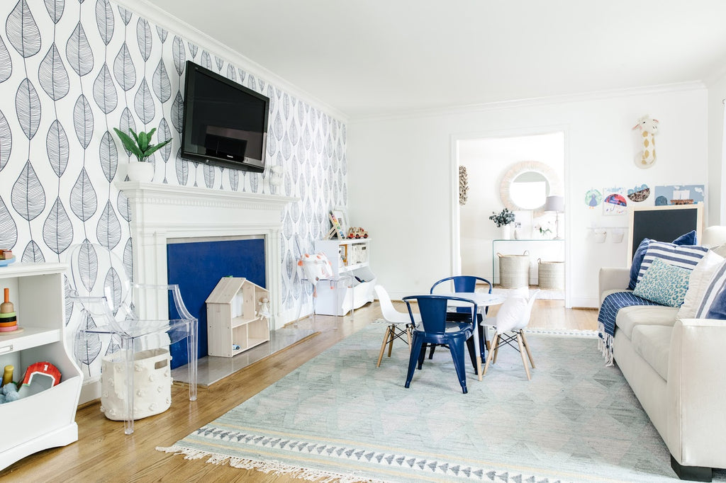 Modern kids playroom design with white walls, light wooden floors and boho coastal decor