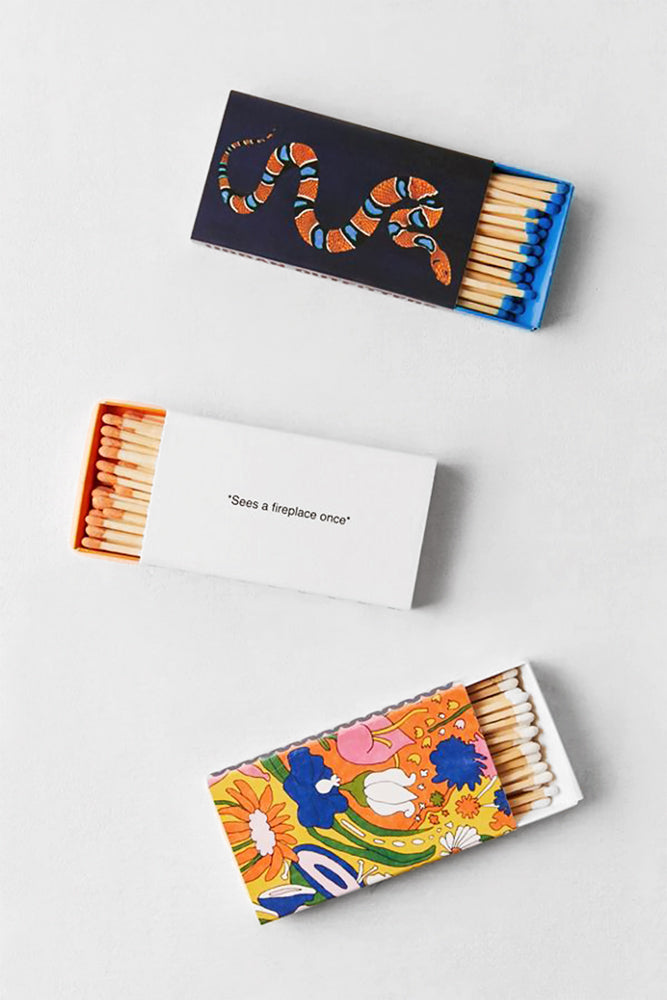 Colorful matches, featuring a custom box with corresponding strike dots along sides