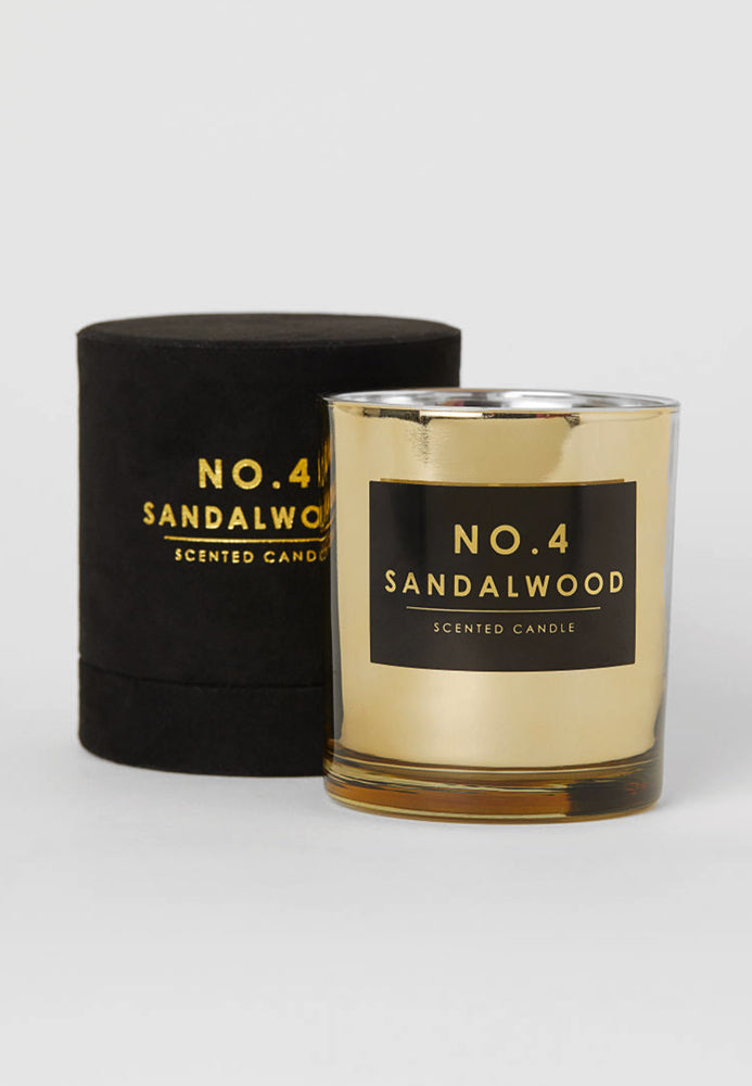 Sandalwood scented candle in a gold glass holder