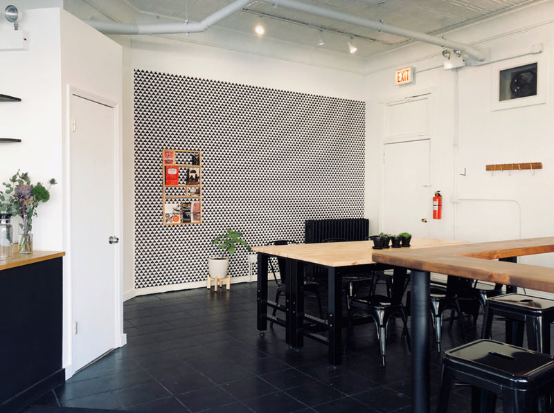 Black and white removable wallpaper in minimal design coffee shop interior