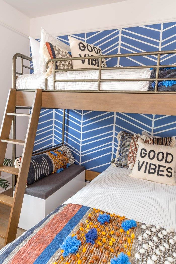 Blue removable wallpaper in boys bedroom interior with eclectic boho beach style