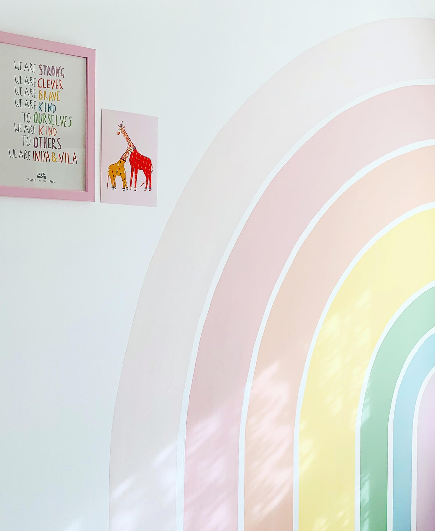 Modern diy rainbow wall mural in pastel colored shared girl's room interior