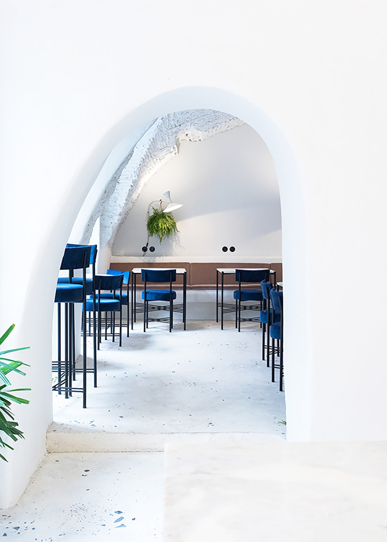 Dear Breakfast interior with blue velvet chairs and marble tables