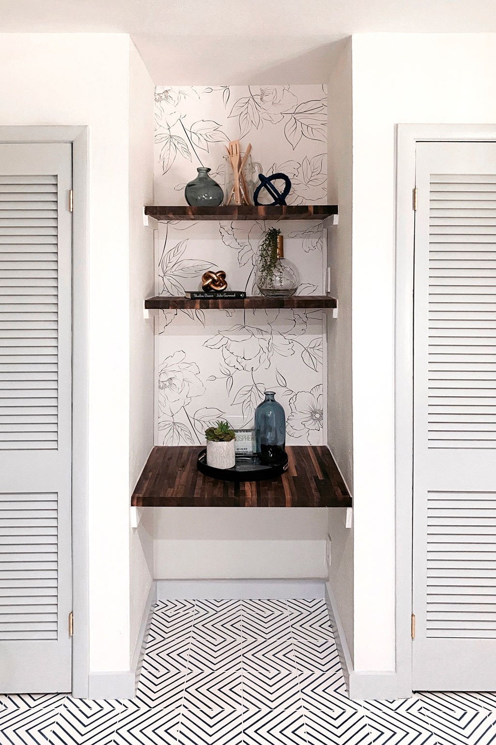 Dining room book shelf nook with floral removable wallpaper feature wall