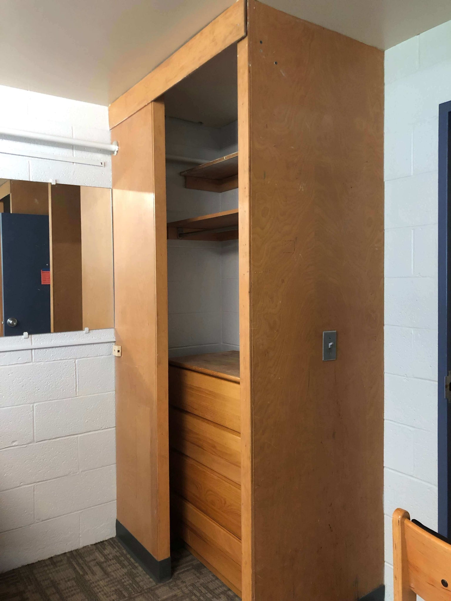 Dorm room before picture with a maple wood closet