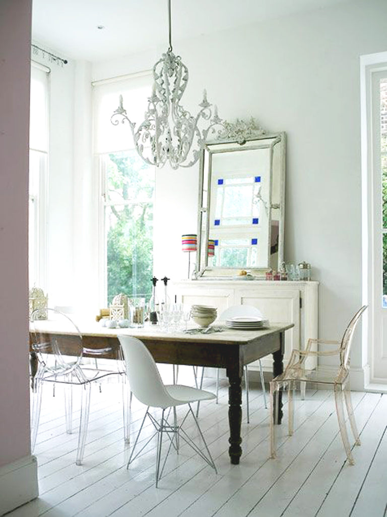 Ghost chair mismatch in white Parisian style interior