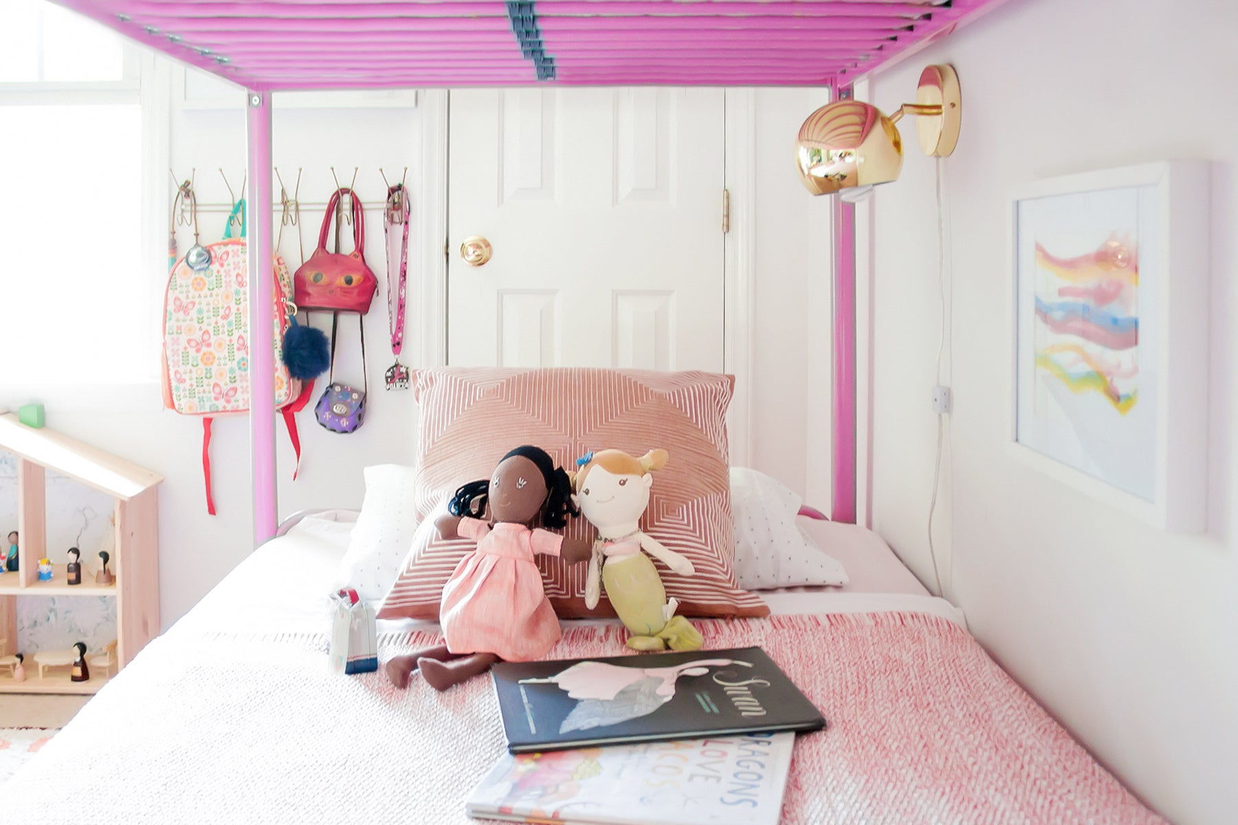Girl's room with plush dolls, IKEA doll house and pink cushions