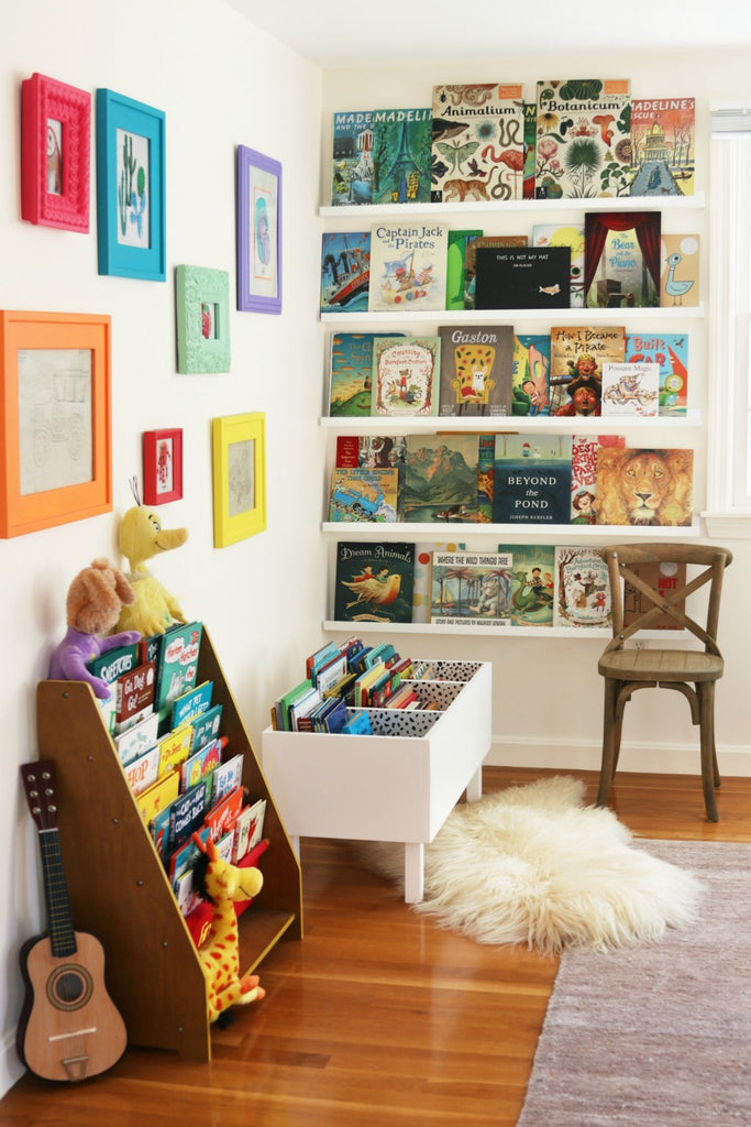 Colorful kids room with book bin and book shelves