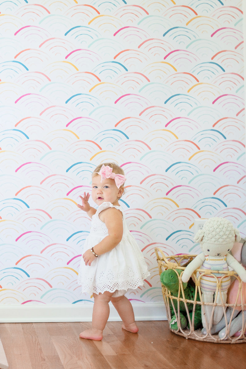 Colorful rainbow wallpaper for playful kids room interior