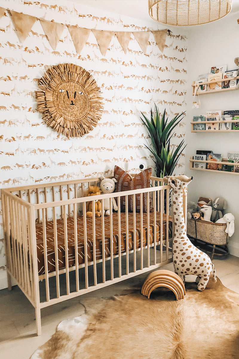 Animal theme inspired nursery interior styled with animal illustration wallpaper
