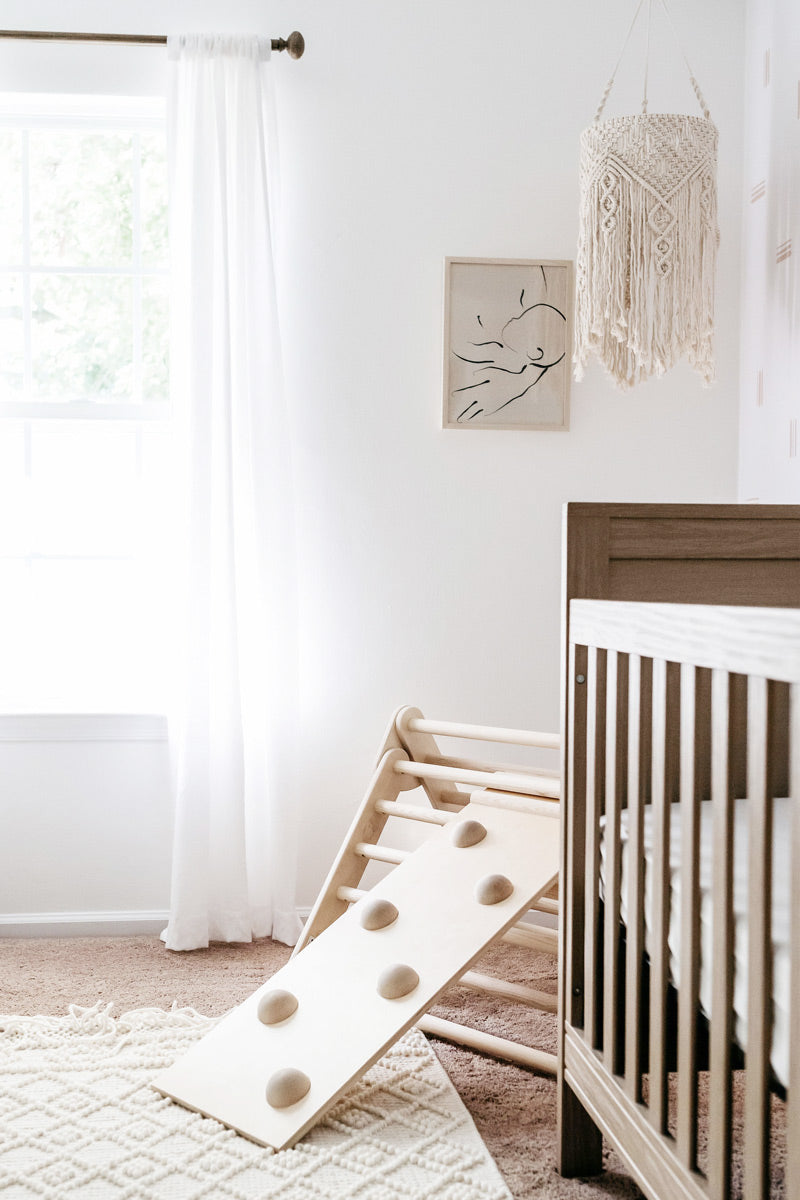 Neutral style nursery interior inspiration with abstract brush stroke wallpaper