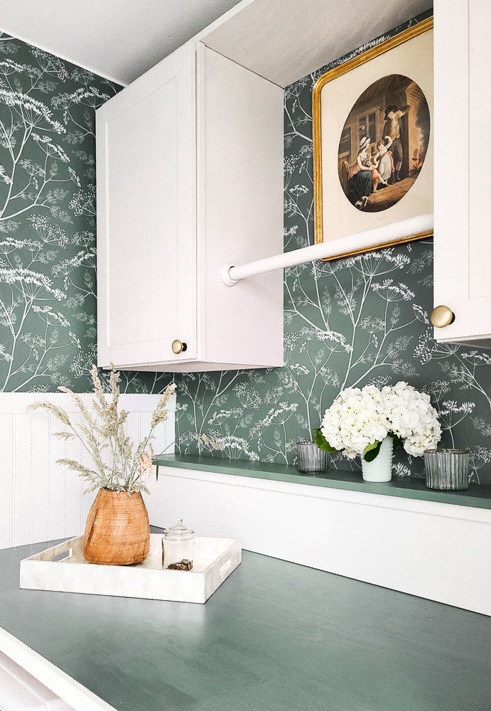 Modern laundry room interior styled with dark green wildflower removable wallpaper
