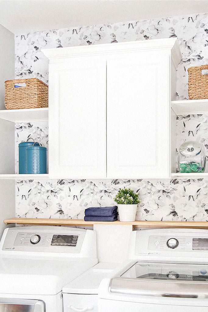 Modern farmhouse laundry room styled with floral removable wallpaper
