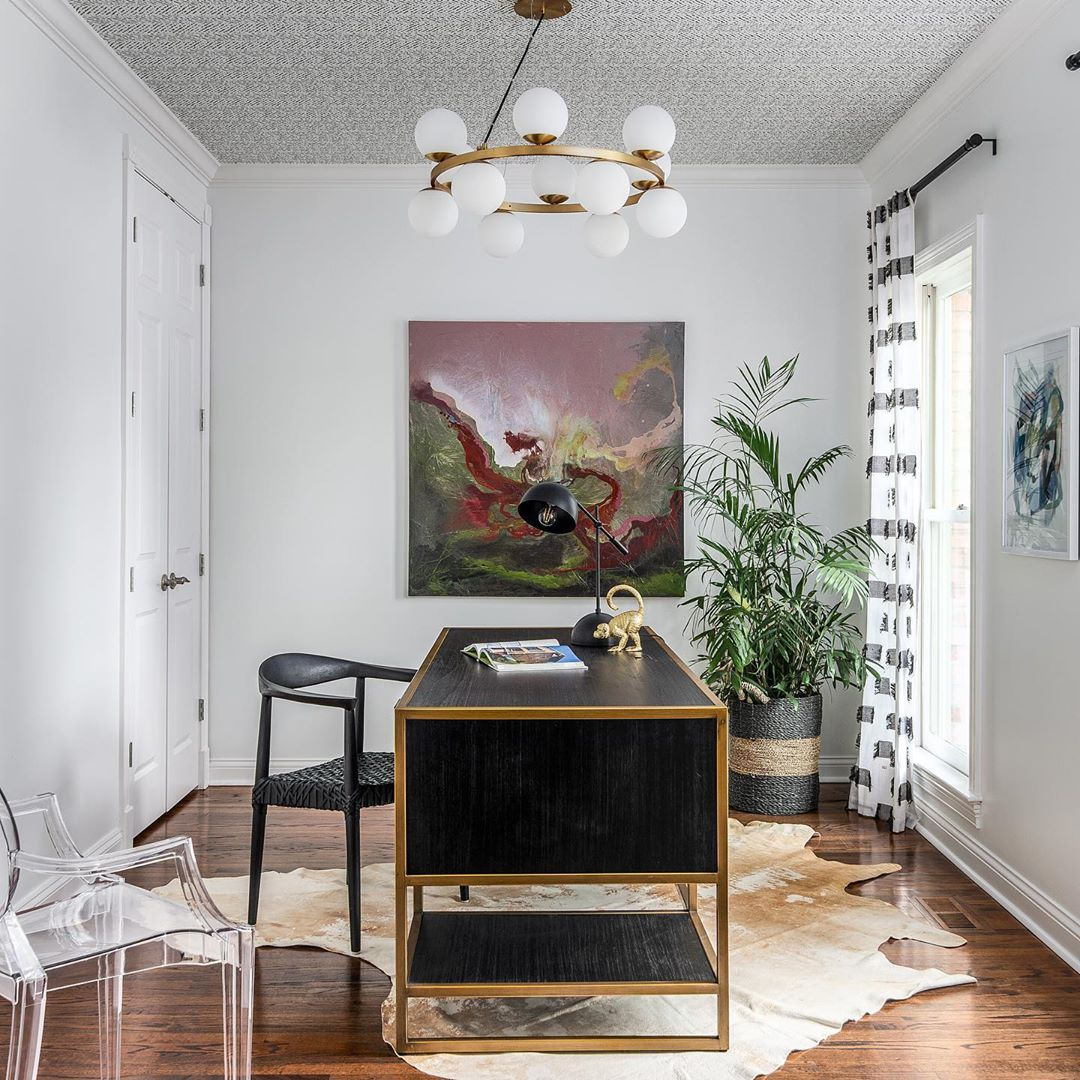 Mid century modern home office interior design with wallpaper on ceiling