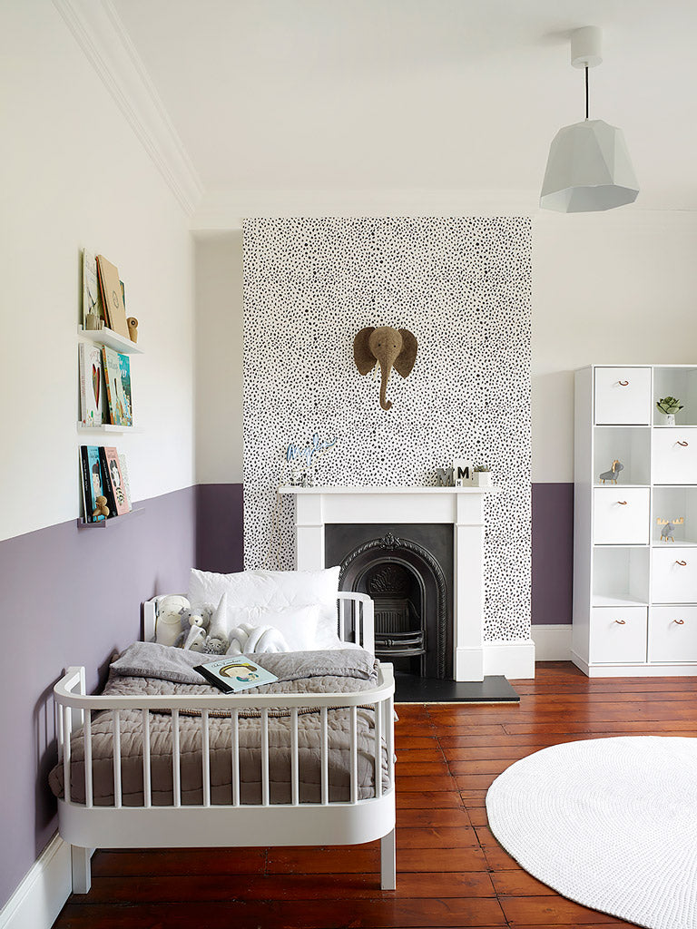 Minimal eclectic kids room with dalmatian print removable wallpaper and animal decor