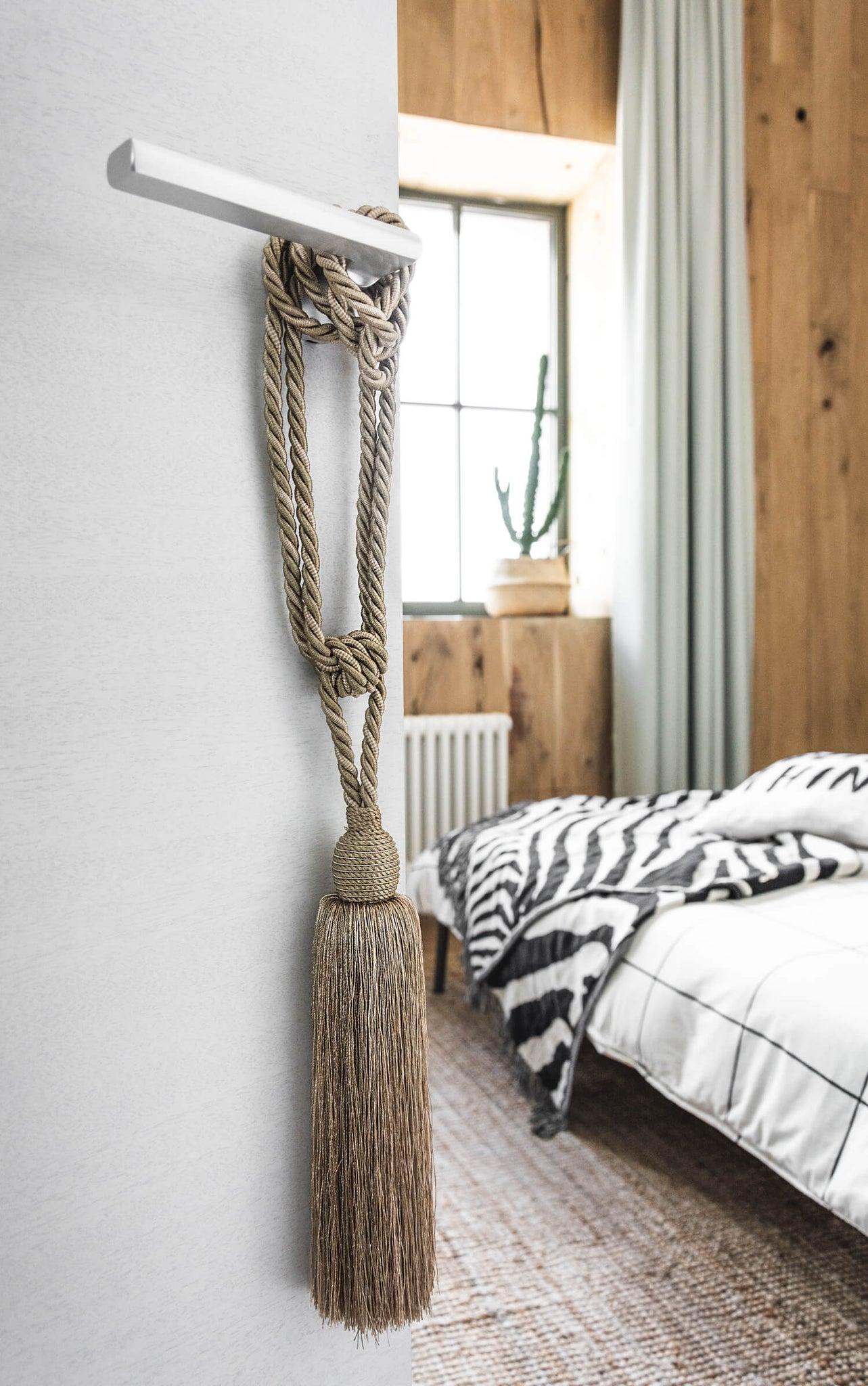 Boho bedroom decor, golden tassel on door knob