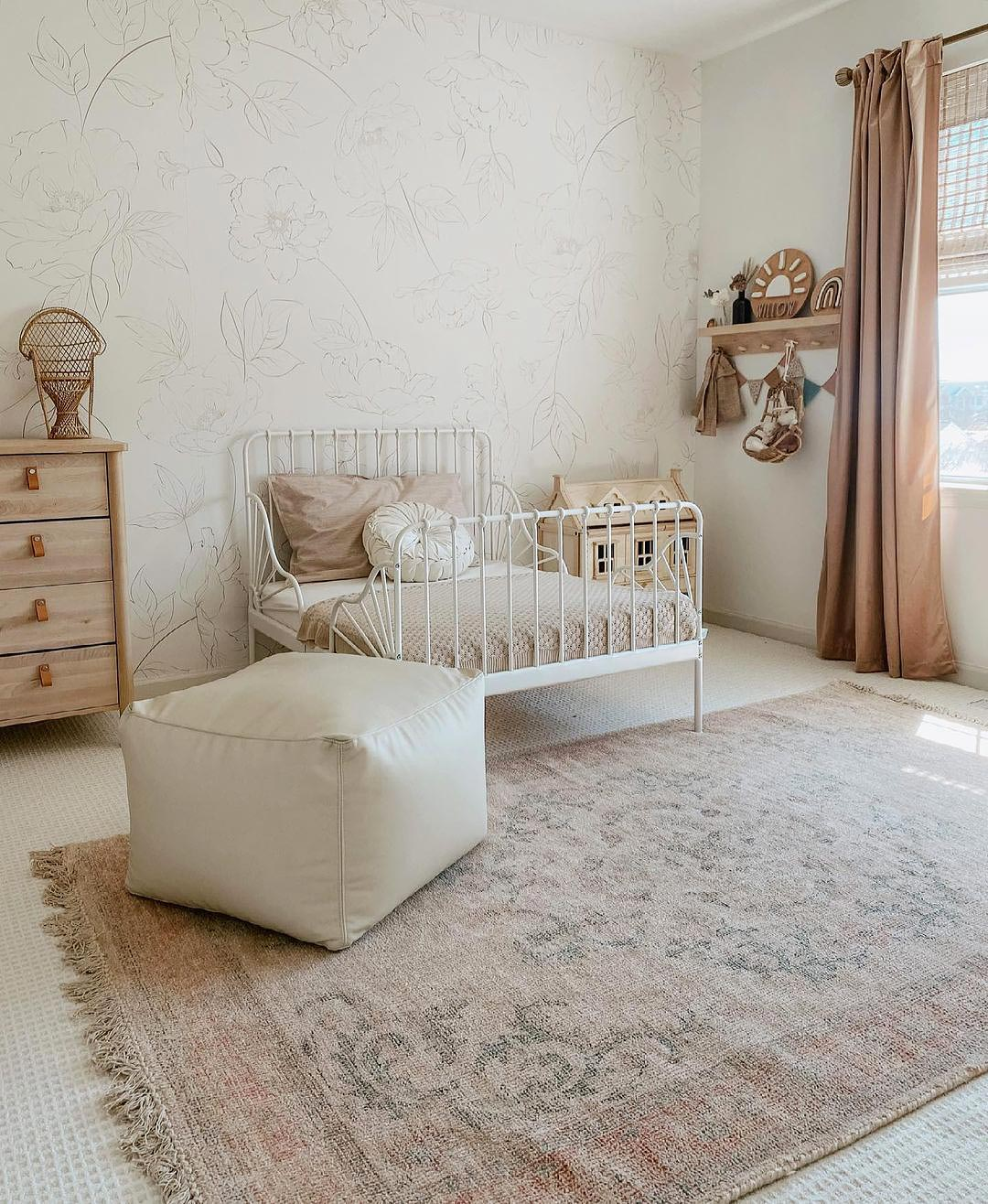 Subtle bohemian style girls room interior with white bed and light wood furniture