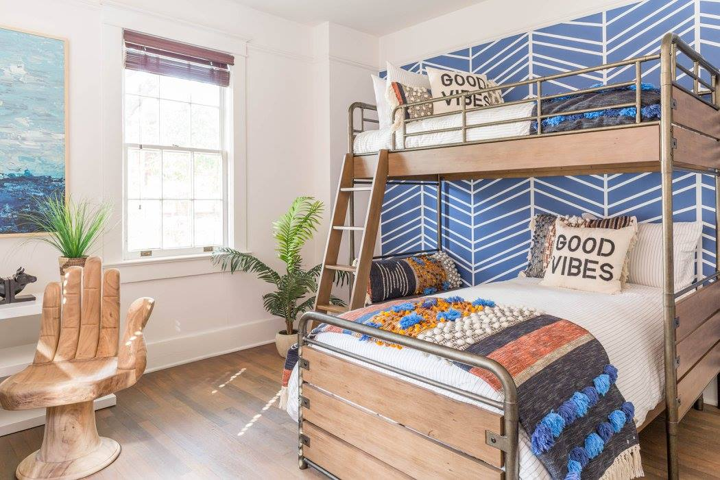 Eclectic beach house boys bedroom with exotic furniture, colorful bed linen and boho throw pillows
