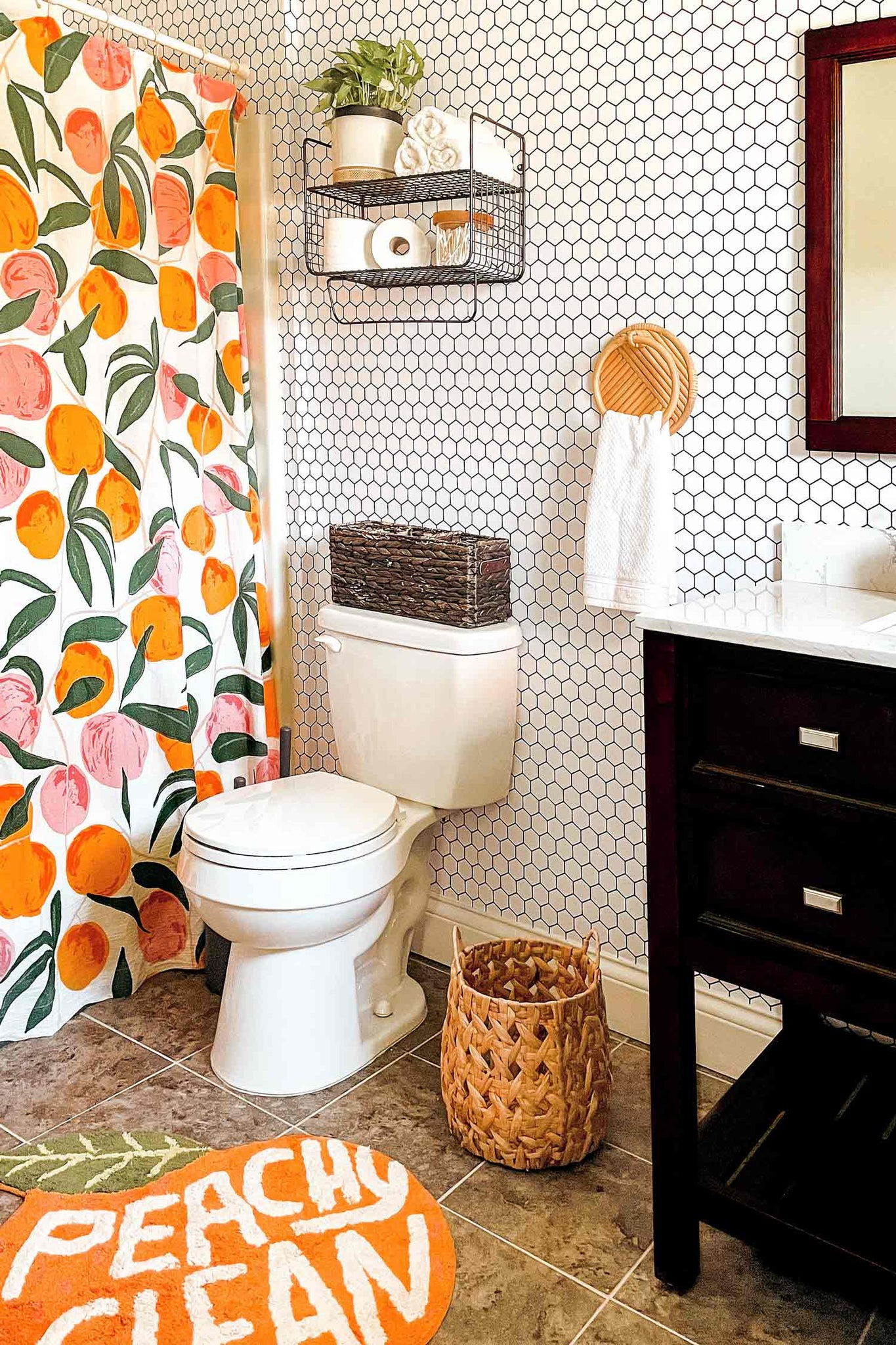 Colorful bathroom interior ideas with peachy shower curtain and floor mat and geometric honeycomb tile removable wallpaper accent wall