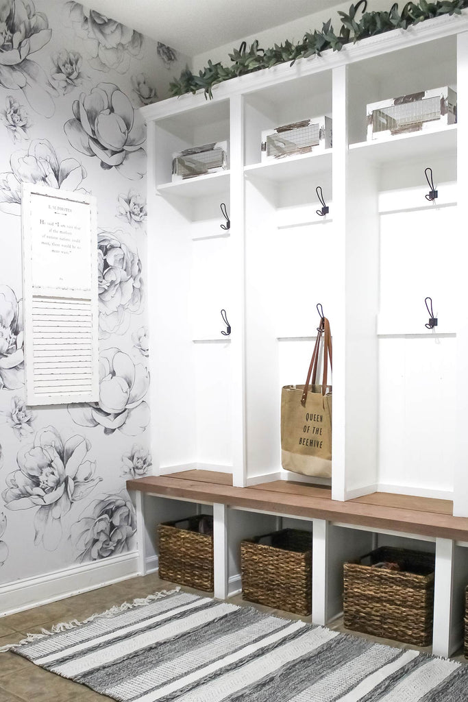 Farmhouse style mudroom styled with large peony removable wallpaper