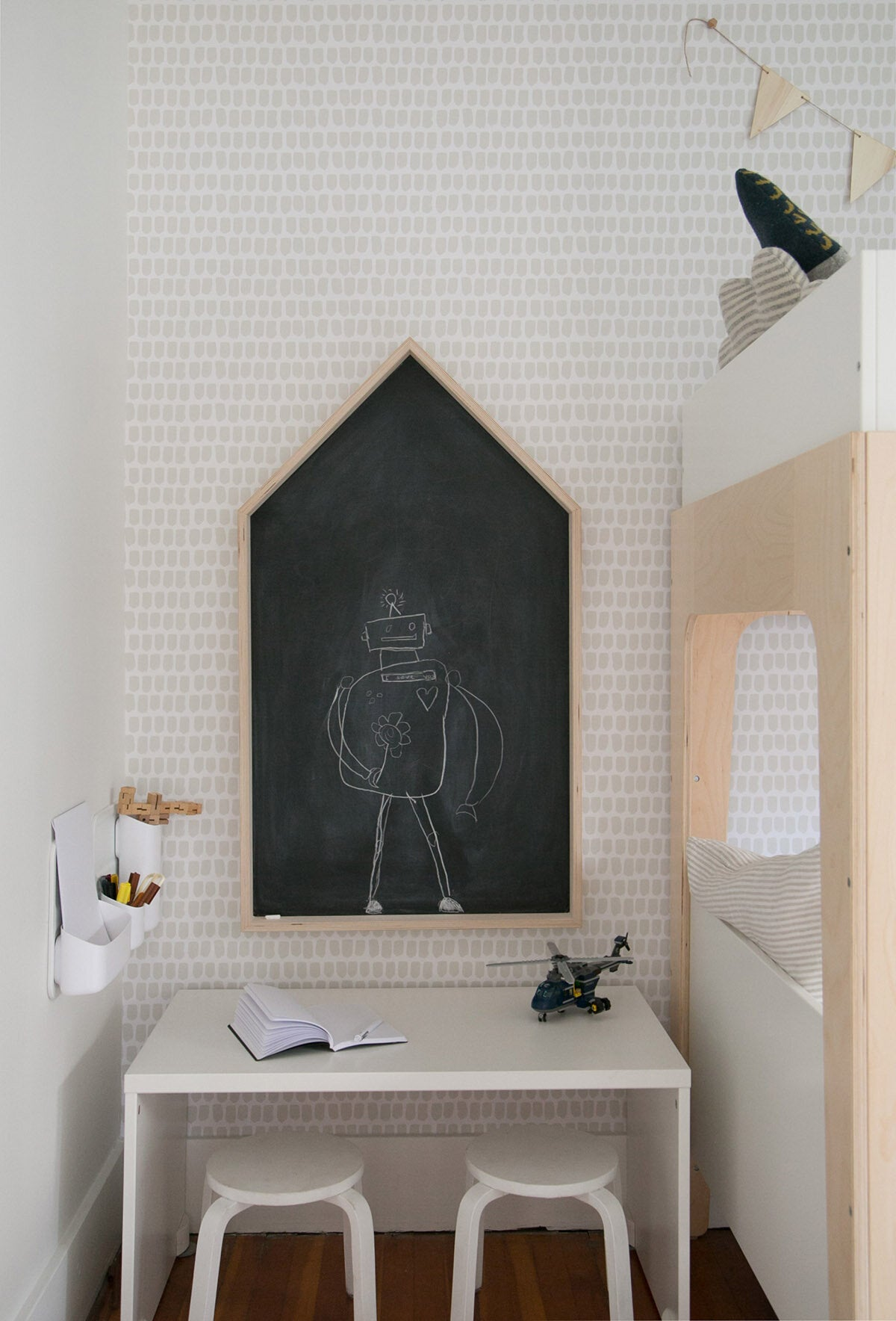 Modern boys room art corner with house shaped chalkboard wall, removable wallpaper and robot theme