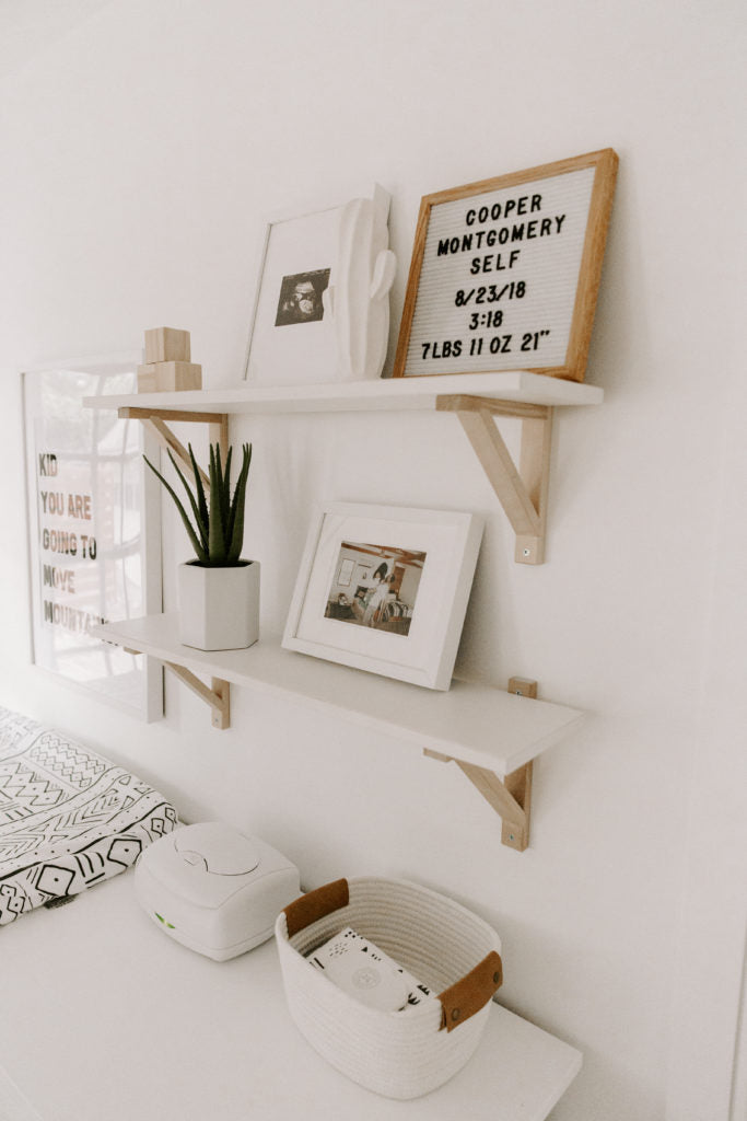 Modern design boho nursery changing table in white interior