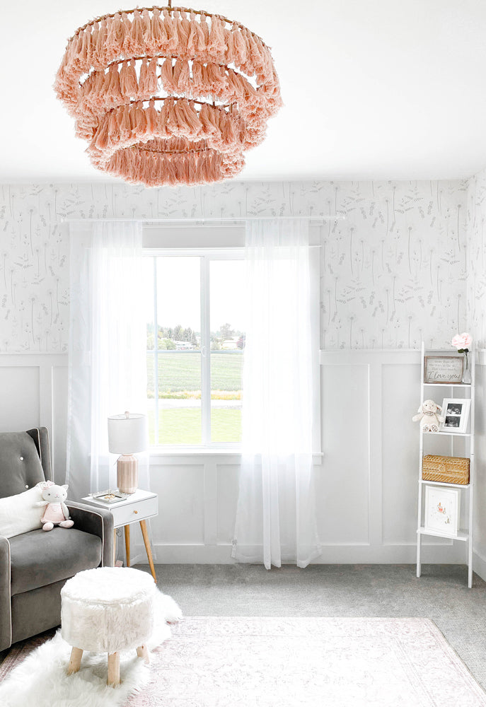Modern white and pink nursery interior styled with delicate wildflower removable wallpaper