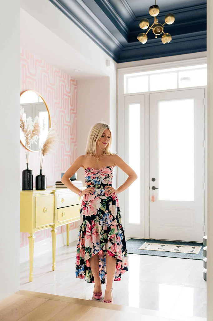 Bright and modern entryway design styled with pink wallpaper