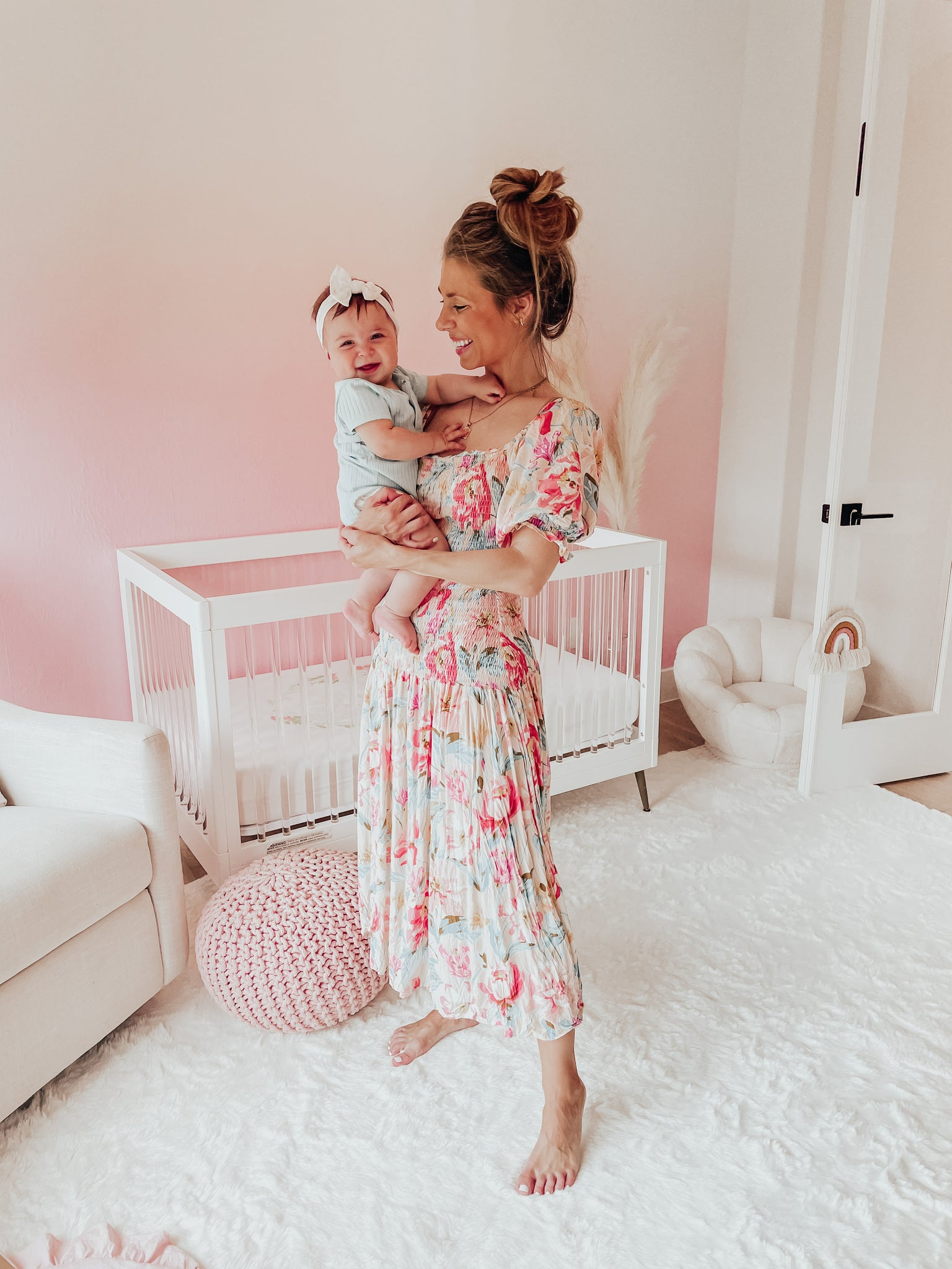 Cute baby pink nursery interior featuring removable wallpaper