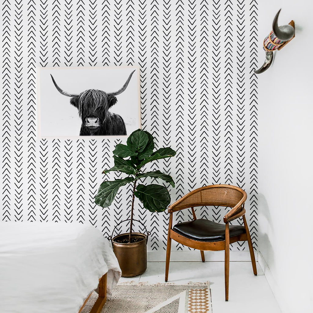 Scandi boho interior with black and white removable wallpaper