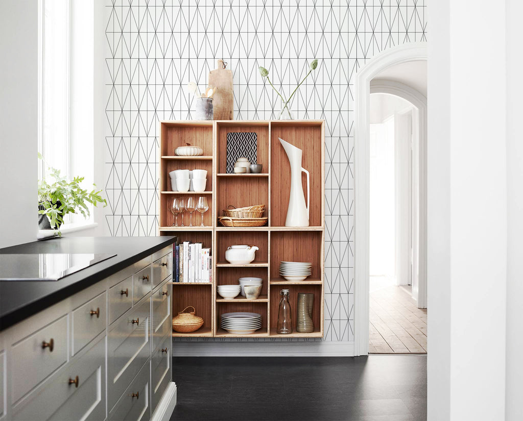 Scandinavian design kitchen with geometric wallpaper