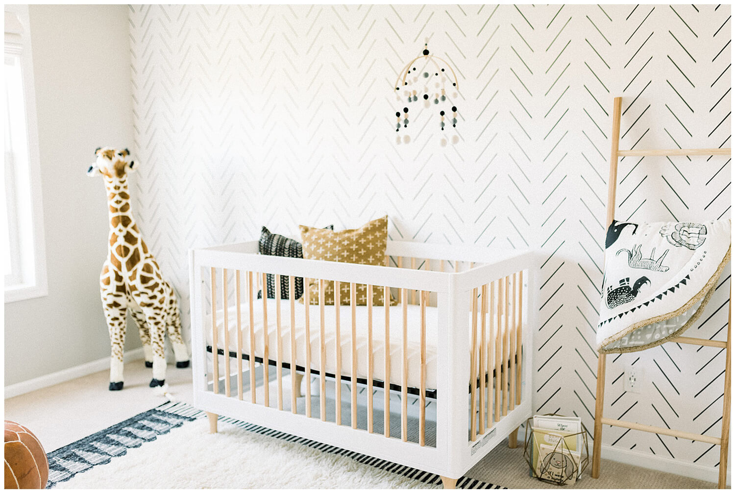 Gender neutral Scandinavian design nursery with Herringbone removable wallpaper