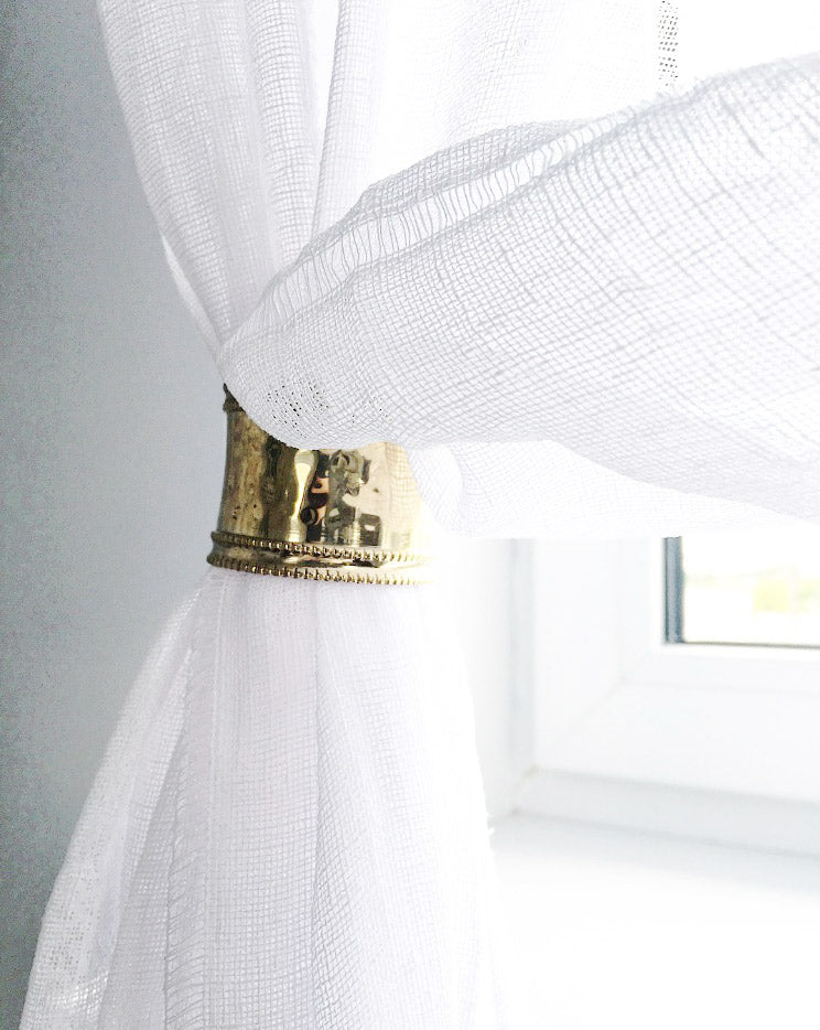 Sheer linen curtains with brass curtain rings
